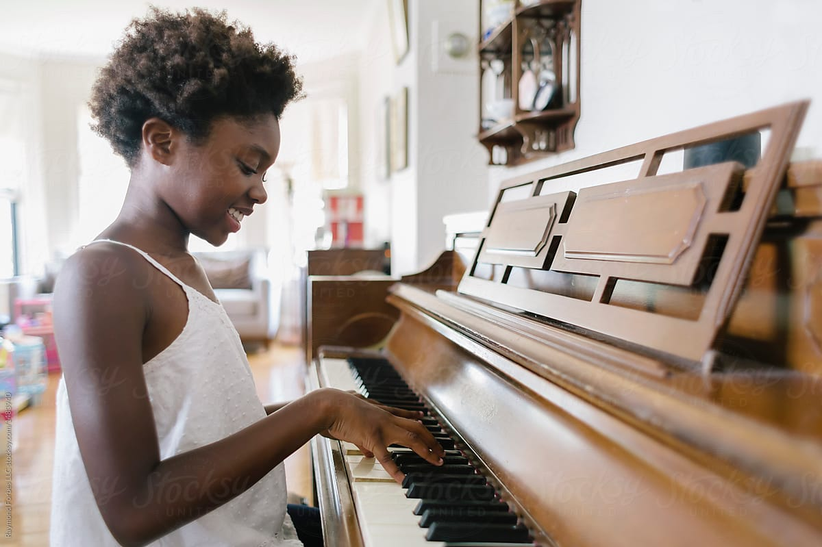 a-girl-playing-a-piano