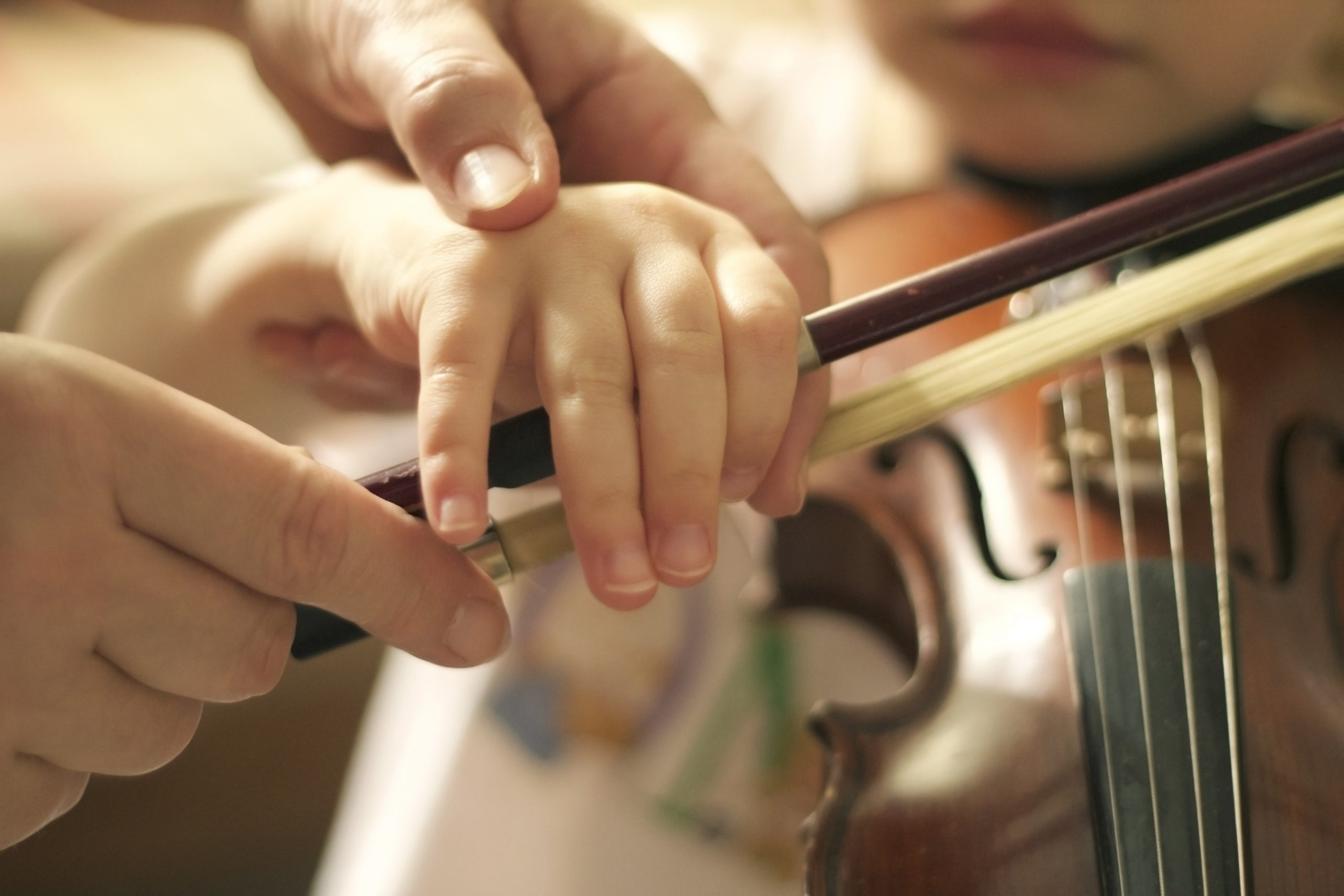 a-kid-playing-a-violin